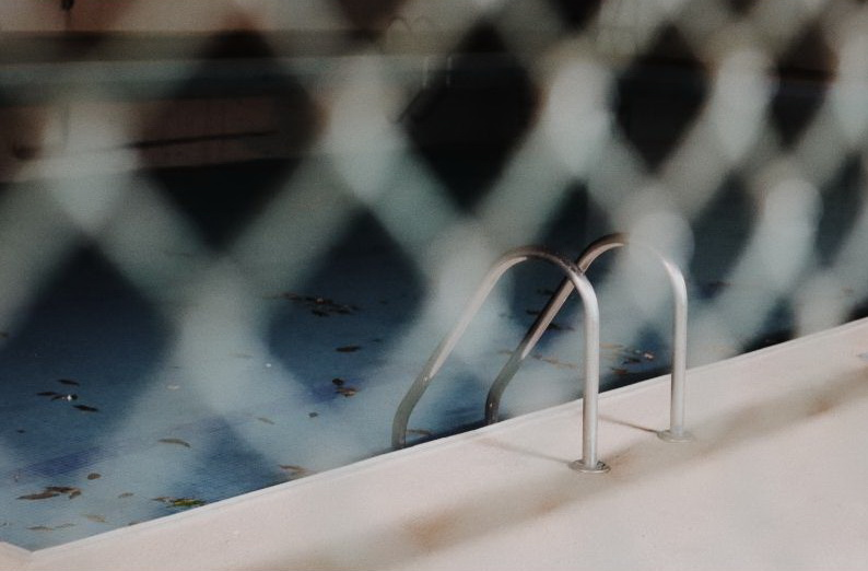 Tools that can be used to prevent swimming pool trespassing and why this is important.